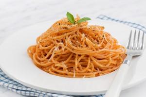 pasta with tomato sauce on a plate, closeup, horizontal